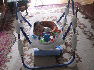 Kaleb in his bouncy toy for the first time