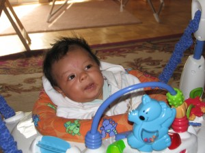A closeup picture of Kaleb in his bouncy toy